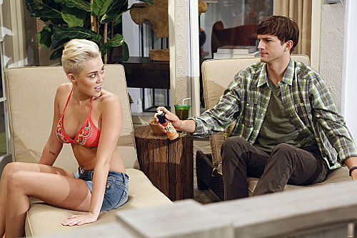 Miley Cyrus wears a bikini on Two and a Half Men.