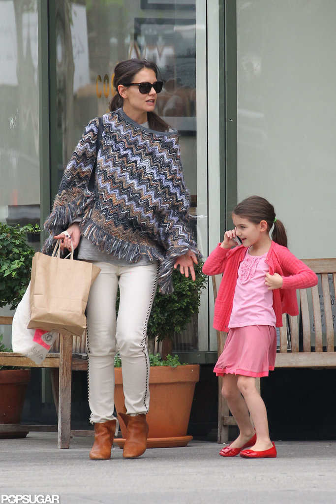 Suri Cruise smiled while she chatted on the phone with Katie Holmes by her side.