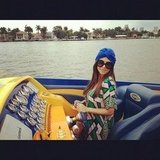 Kourtney Kardashian looked chic in a printed caftan and turban while boating. Source: Instagram user kourtneykardash