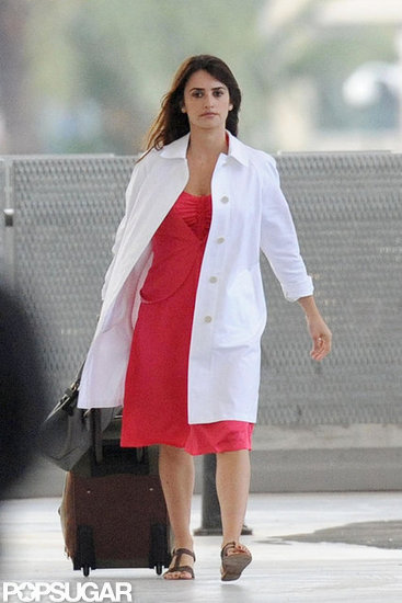 Penelope Cruz dragged a suitcase during a scene.