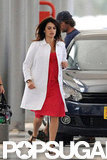 Penelope Cruz switched into a red dress and white coat.