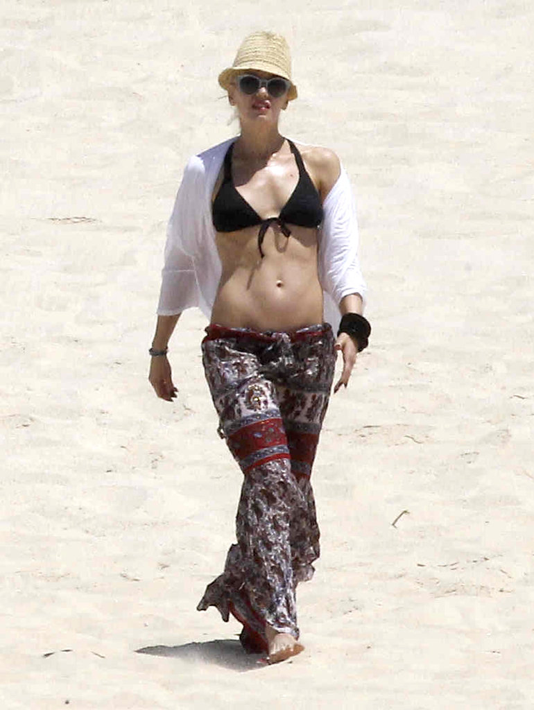 Gwen Stefani's six-pack abs were on display in a black bikini during a trip to Mexico in April 2012.