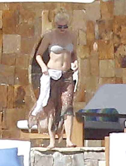 Gwen Stefani lounged by the pool while on a family vacation in Cabo San Lucas, Mexico, in April 2012.