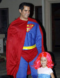 Cash Warren sported a Superman costume with Honor by his side in LA in 2011.