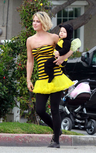 Ali Larter matched with her son, Hayes, in a bumblebee suit on their way to an LA bash in 2011.