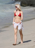 Gwen Stefani's tiny red bikini helped show off her amazing body during a St. Barts beach day in January 2009.