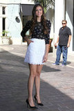 Nina Dobrev showed off her figure in a short white skirt.