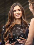 Nina Dobrev wore a sexy, sheer, black shirt.