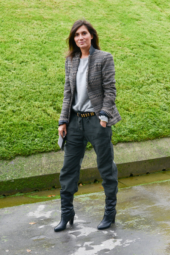 "Emmanuelle Alt reworked a variation on her ""uniform"" in a pair of gray trousers and a printed blazer."