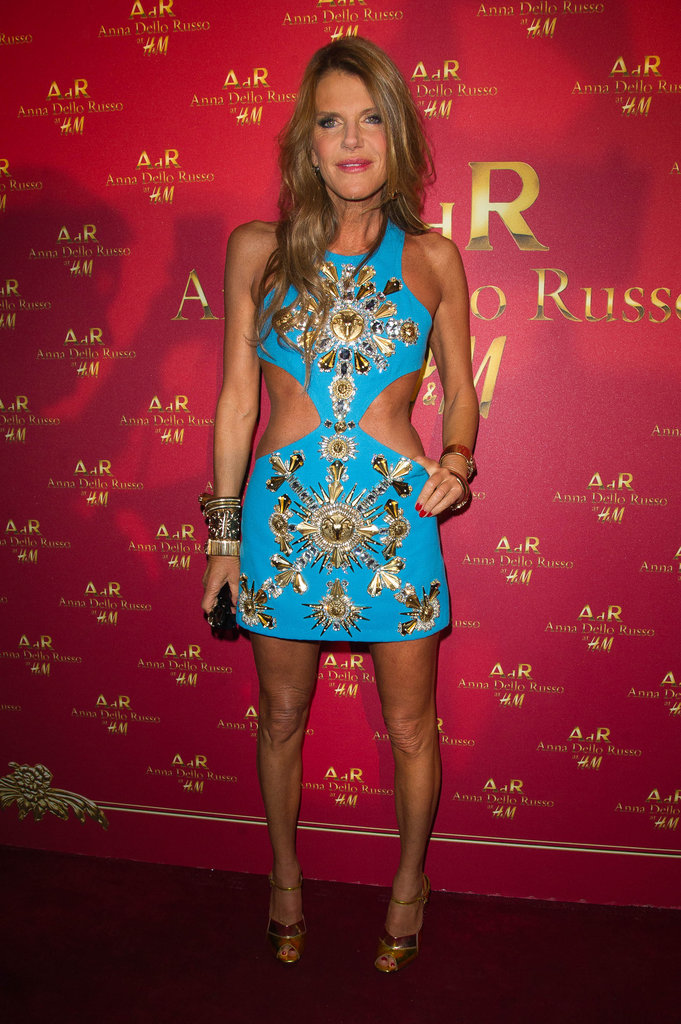 Anna Dello Russo showed off her midriff in a Baroque-inspired blue minidress, complete with side cutouts, at her H&M launch party.