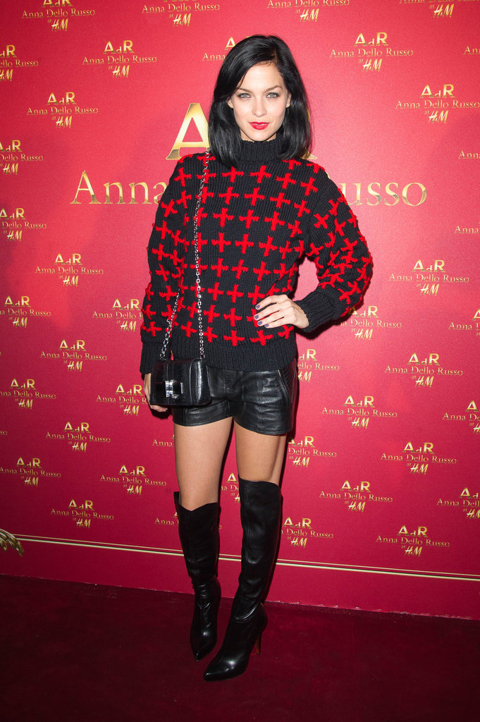 Leigh Lezark dressed up a cross-embellished sweater with black leather shorts and sexy knee-high boots at the Anna Dello Russo for H&M launch party.