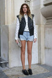 A studded moto vest and embellished Western-style booties upped the ante on cutoffs and a blouse.