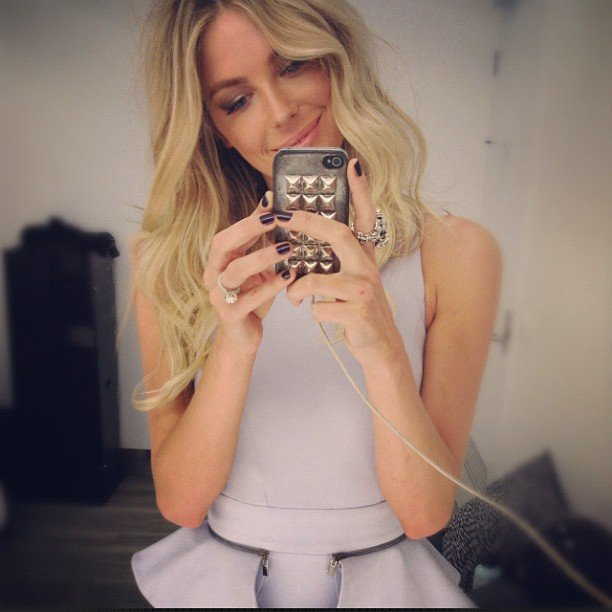 Jennifer Hawkins modelled a peplum dress and tough studded phone case. Source: Instagram user jenhawkins_