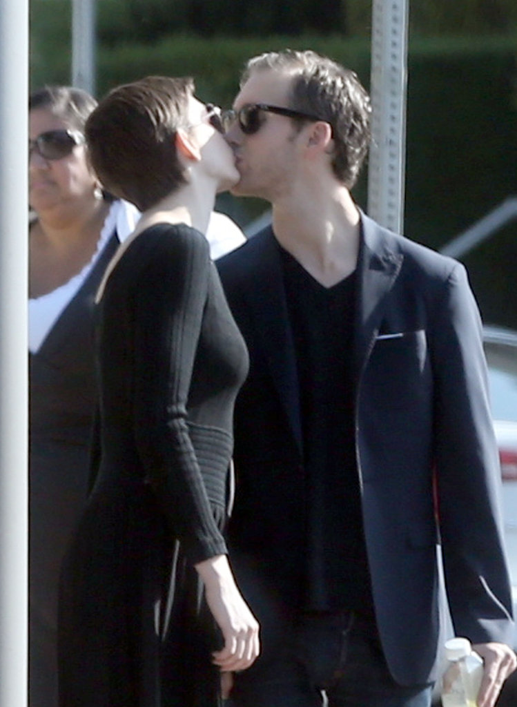 Anne Hathaway kissed Adam Shulman on the streets of LA in September 2012.