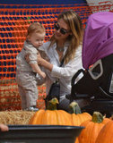 Jessica Alba played with Haven Warren on the hay barrels at the pumpkin patch.
