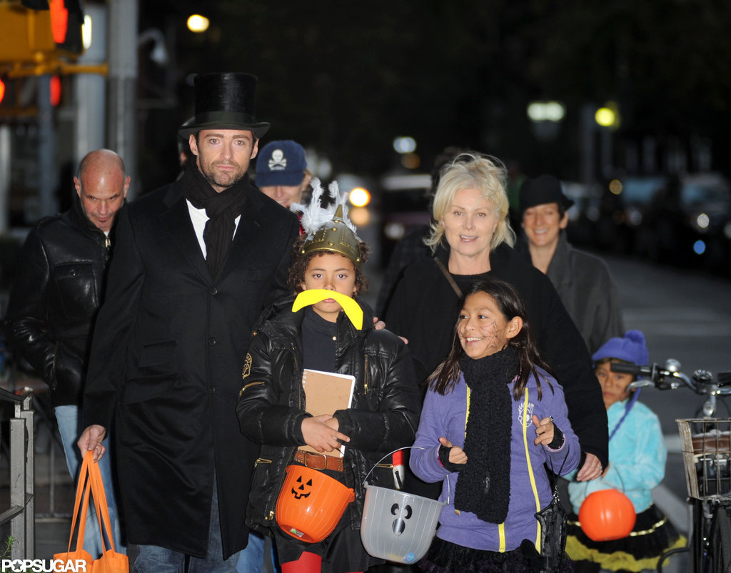 Hugh Jackman put on a top hat and coat for a Halloween night out in NYC with his whole family in 2009.