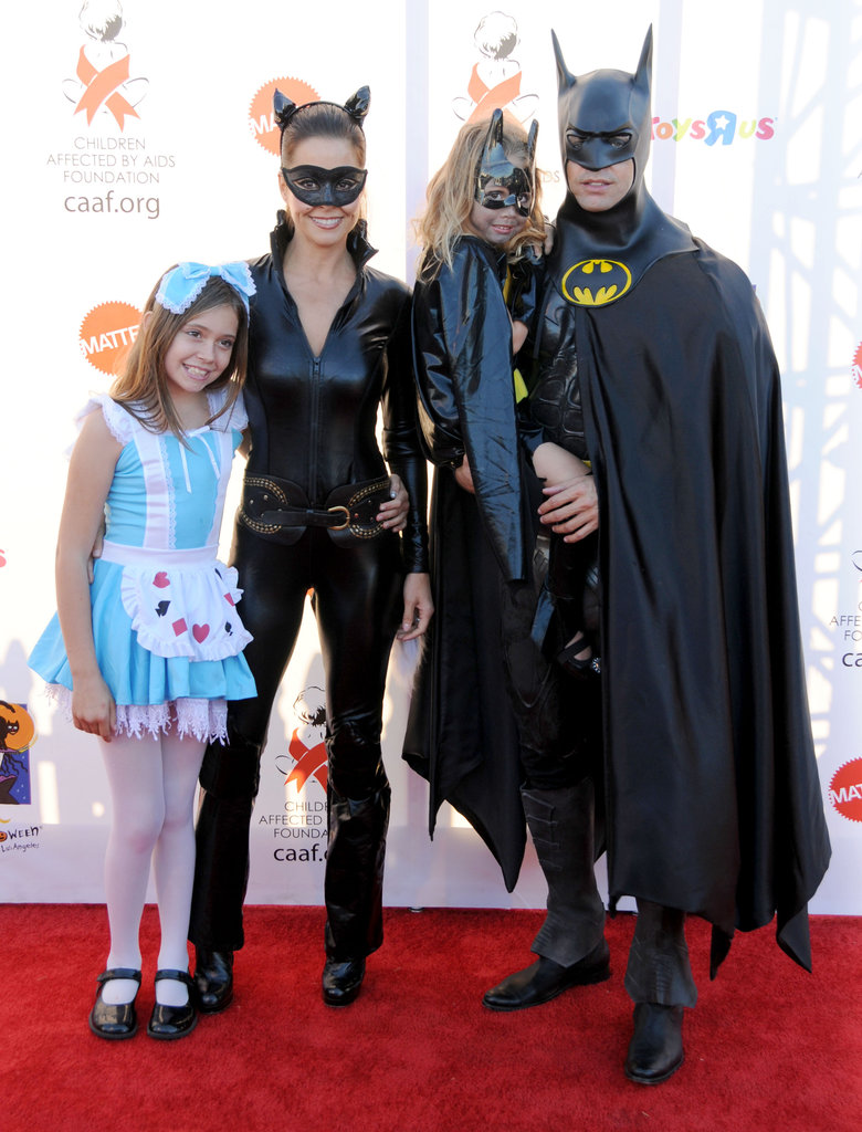 Brooke Burke and David Charvet teamed up as Batman and Catwoman for an LA Halloween party with their kids in 2010.