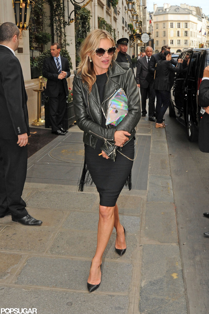 Kate Moss wore a black dress and leather jacket.