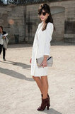 Caroline Sieber offset her white coatdress with a cool pair of oxblood ankle boots outside of Chloé.