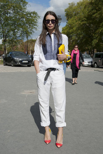 Slouchy trousers and an oversize button-down got a touch of femininity via her pointed-toe pumps.
