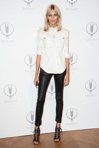 Anja Rubik knows how to work a pair of black leather pants. Take note: a structured white top and a sexy pair of lace-up heels will do the trick.