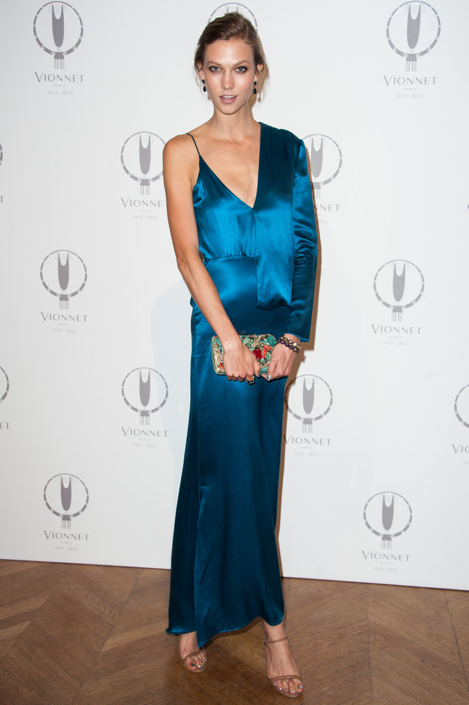 Karlie Kloss played with proportions via a sleeve vs. no sleeve gown — in the prettiest shade of blue, no less.