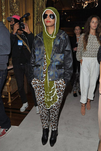 M.I.A stayed all wrapped up, while still letting her leopard-print jumpsuit peek through, at the Stella McCartney show.