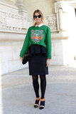 Her Kenzo sweatshirt gave this pencil skirt sporty appeal.