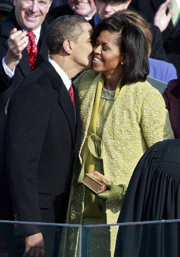 Barack planted a kiss on Michelle during the inauguration.