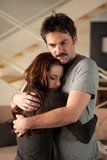 Bella hugs her dad, Charlie, in Breaking Dawn Part 2.