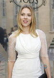 Scarlett Johansson showed off her figure in a white Dior dress at the Tod's party in Paris.