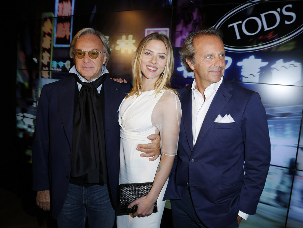 Scarlett Johansson posed with Tod's CEO Diego Della Valle and friends at the Tod's Party for Paris Fashion Week.