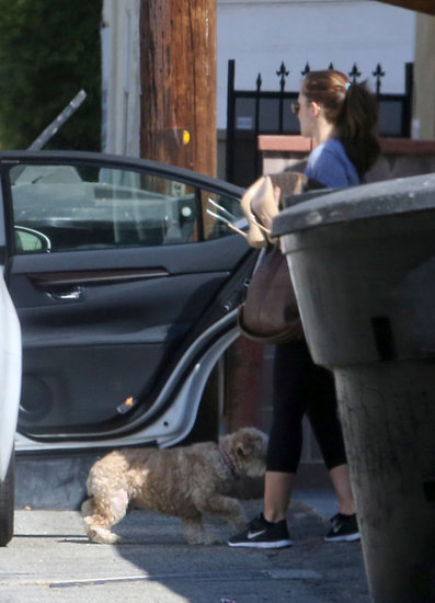 Minka Kelly and her dog hopped out of the car.