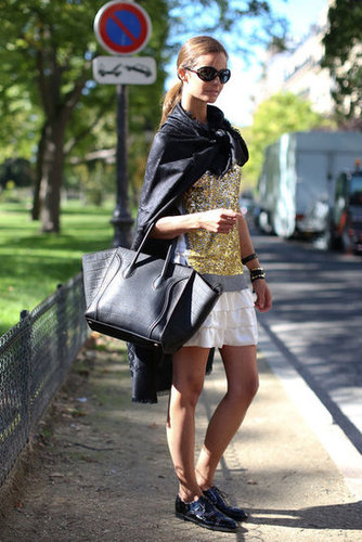 A glittery top plays well with a ruffled skirt, while a Céline tote and brogues do their part to ground the look.