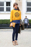 A pop of yellow on her cheeky sweatshirt lent a cool-girl dynamic to her denim on denim.