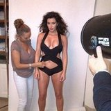 Kim Kardashian got some help from a stylist during one of her sexy swimwear shoots. Source: Instagram user kimkardashian