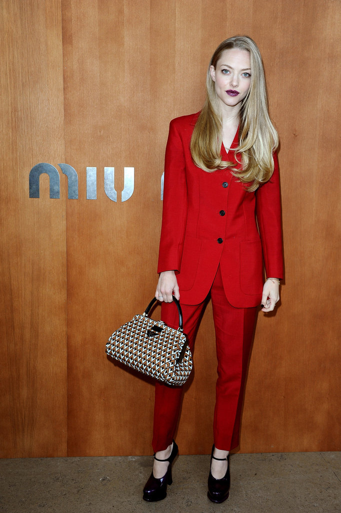 Amanda Seyfried wore a bright red suit to attend the Miu Miu show during Paris Fashion Week.