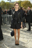 Olivia closed out the week in Paris at Dior, opting for girlie flared Christian Dior dress, then topping it with a leather-paneled jacket from the label as well. Per usual, it was her mix of accessories that sealed the deal — a furry Dior chain-strap bag and perfectly ladylike Giuseppe Zanotti pumps. 8761624