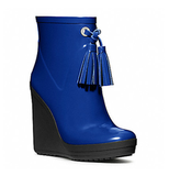 A modern wedge-and-tasseled twist on the bright rain boot — plus, that vibrant shade of this blue Coach rainboot ($228) is bound to cheer you up on even the gloomiest of days.