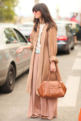 Neutral layers may be understated, but her rose-colored glasses certainly are not.