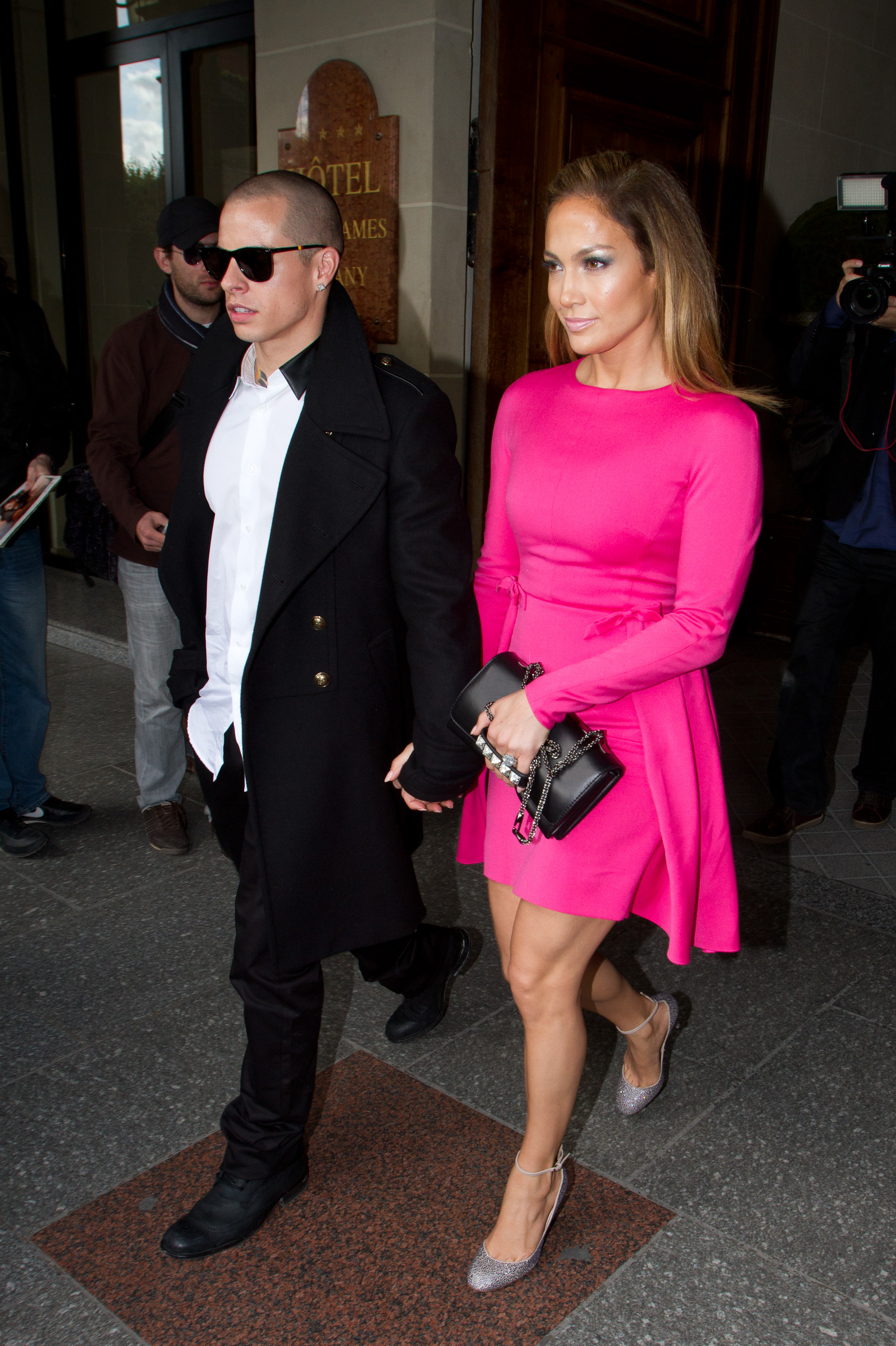 Jennifer Lopez changed into a bright pink dress and lavender ankle-strap pumps for her appearance at Valentino.