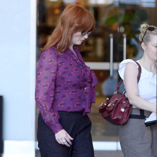 Christina Hendricks Wearing Purple Blouse