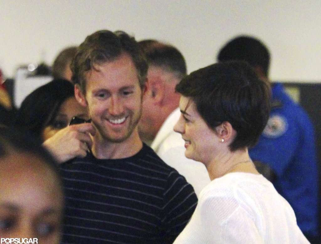 Anne Hathaway and Adam Shulman caught a flight after their wedding.