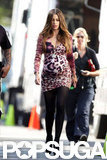 Sofia Vergara covered a fake baby bump with a tight dress on the set of Modern Family in LA.
