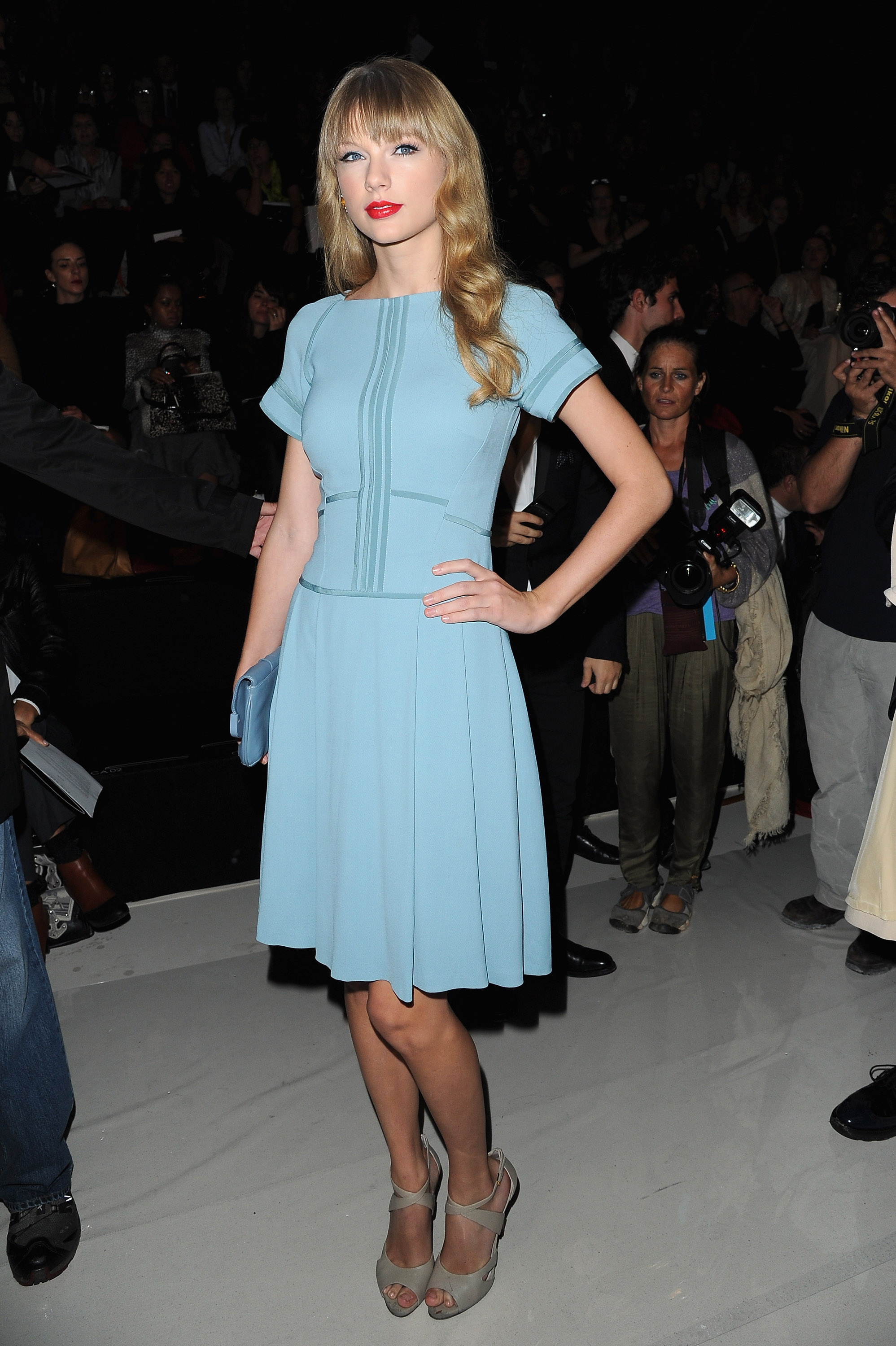 Taylor Swift, in a pale blue creation and nude peep-toe pumps, sent photographers into a frenzy with her front-row appearance at Elie Saab.