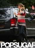 Pregnant Gisele Bündchen showed off her baby bump under a striped sweater in Boston.