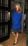 Taylor Swift showed off an adorable early Fall ensemble, complete with a sweet cobalt coat, while visiting London.