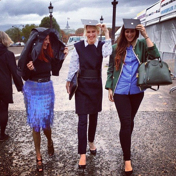 Taylor Tomasi Hill and the Moda Operandi girls take shelter from the rain at Fashion Week. Source: Instagram user ttomasihill