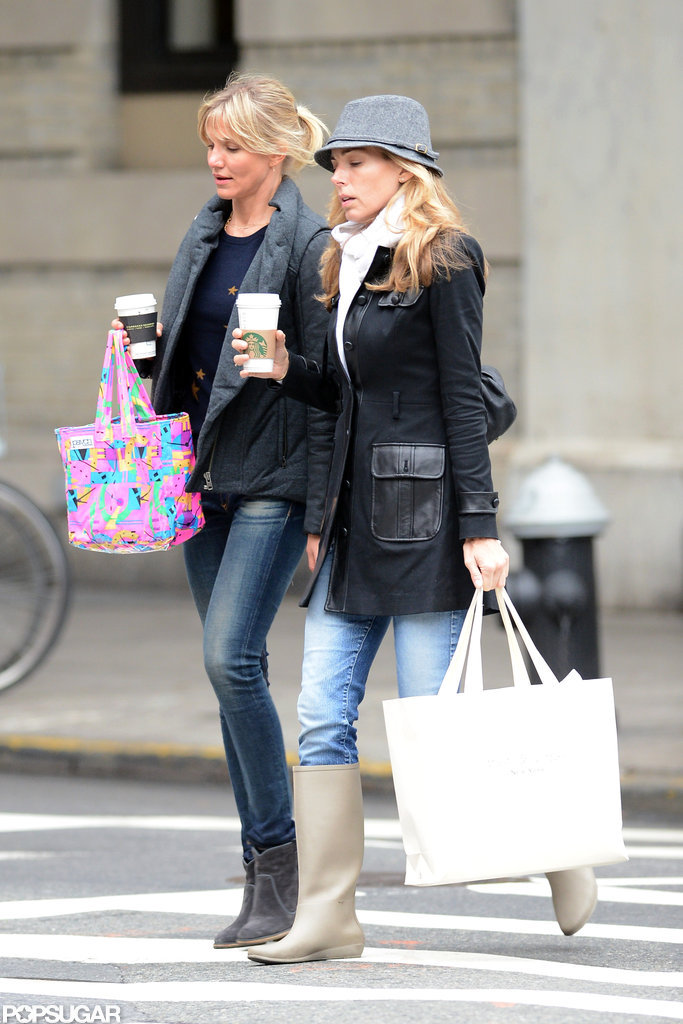Cameron Diaz and her friend carried coffees as they shopped around NYC.