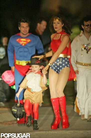 Kate Beckinsale dressed as Wonder Woman along with her husband, Len Wiseman, and daughter Lily Sheen in 2004.